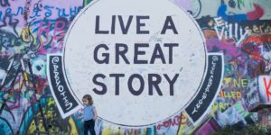 sign that says live a great story