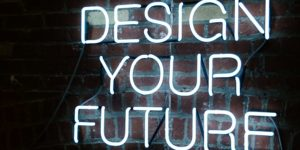 image of a glowing sign that says design your future